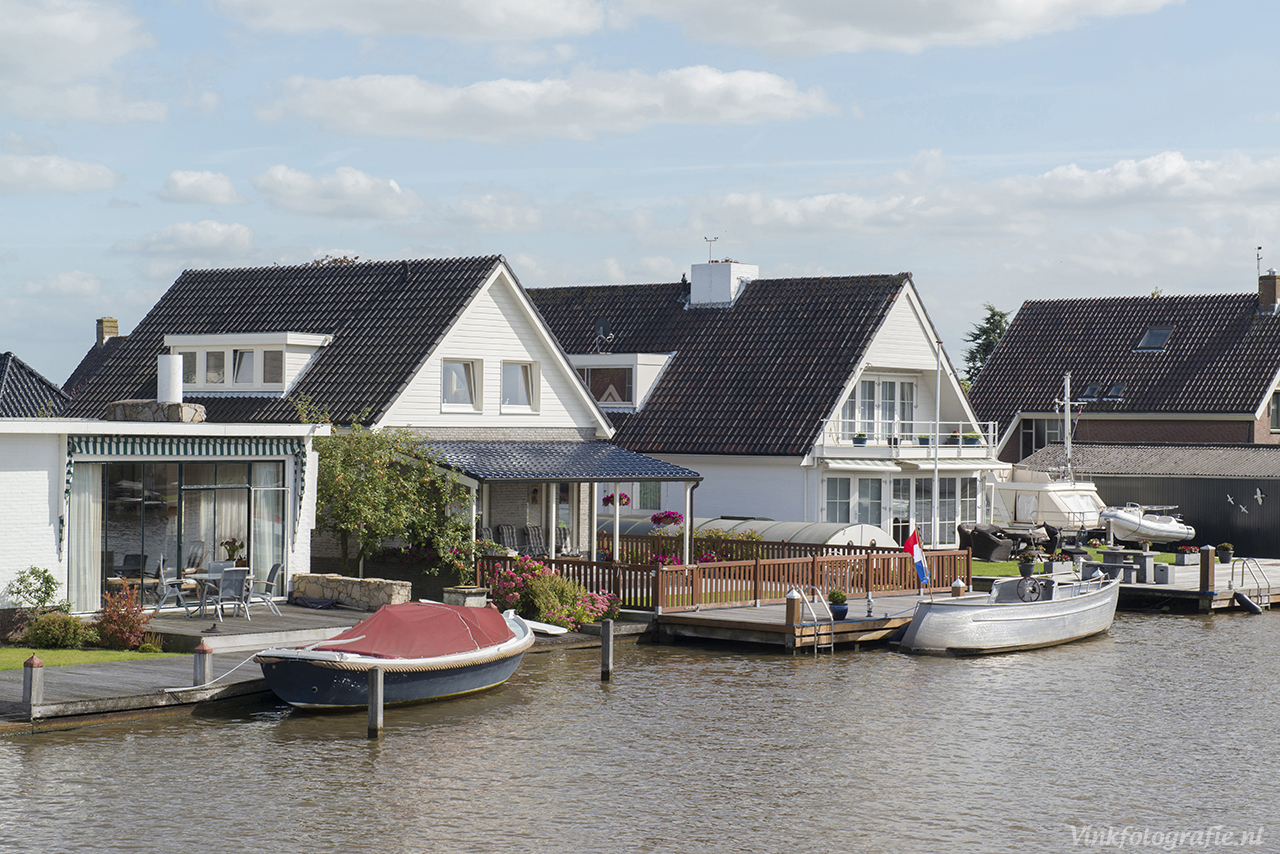 Huis en boot aan water foto for Verkoop huizen